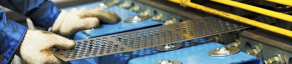worker's hand operating guillotine shears machine